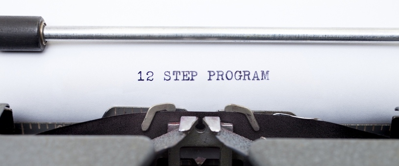Closeup of the words 12 Step Program in a typewriter.