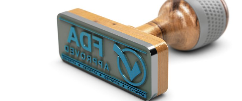 Rubber stamp with FDA Approved mark.