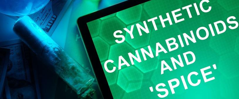 Tablet with the words synthetic cannabinoids and spice in view.