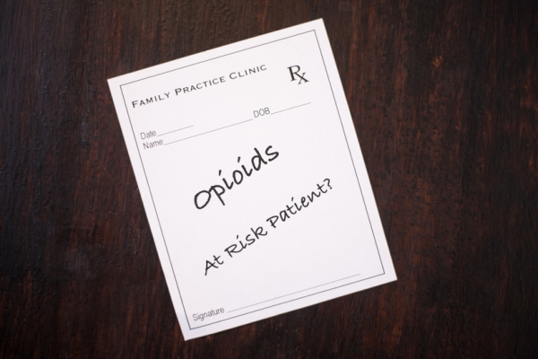 Prescription slip with the word 'Opioids' written.