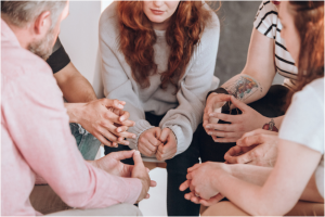Patients sitting next to each other during group therapy.