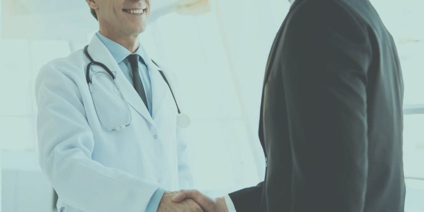 A doctor and a patient shake hands due to multiplan insurance coverage for rehab