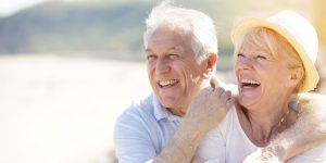 Elderly couple with Humana insurance laugh and