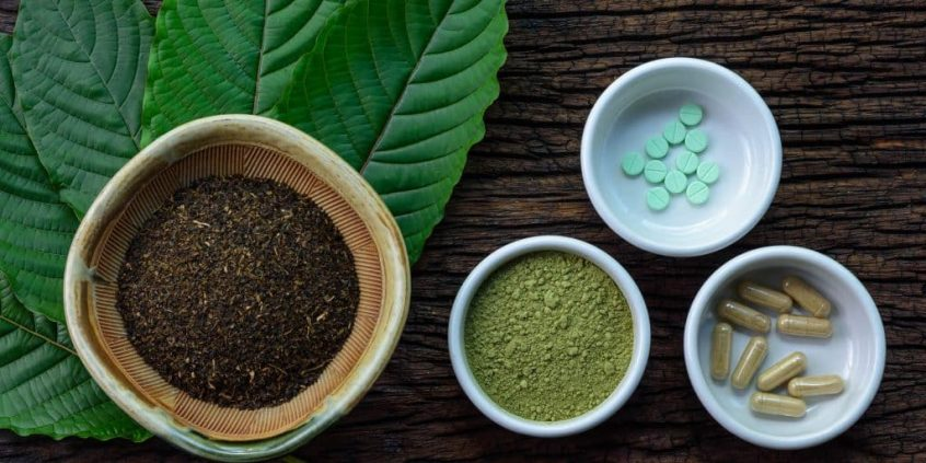 Kratom in its different forms including power, pills, and casules.